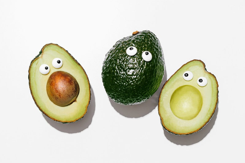 Funny avocados with googly eyes on them.