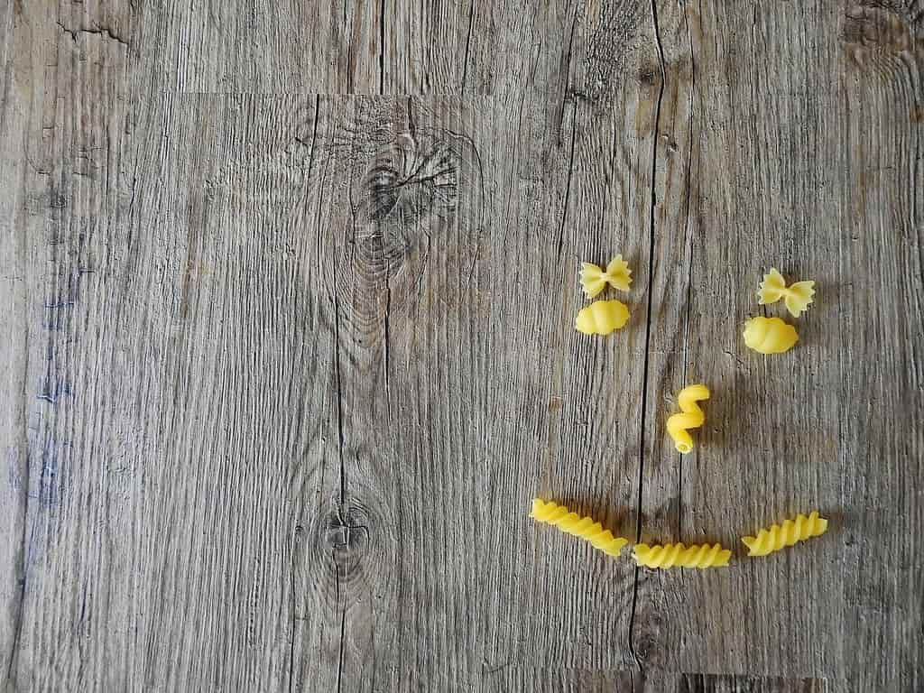 Smiley face made out of different type of pasta.
