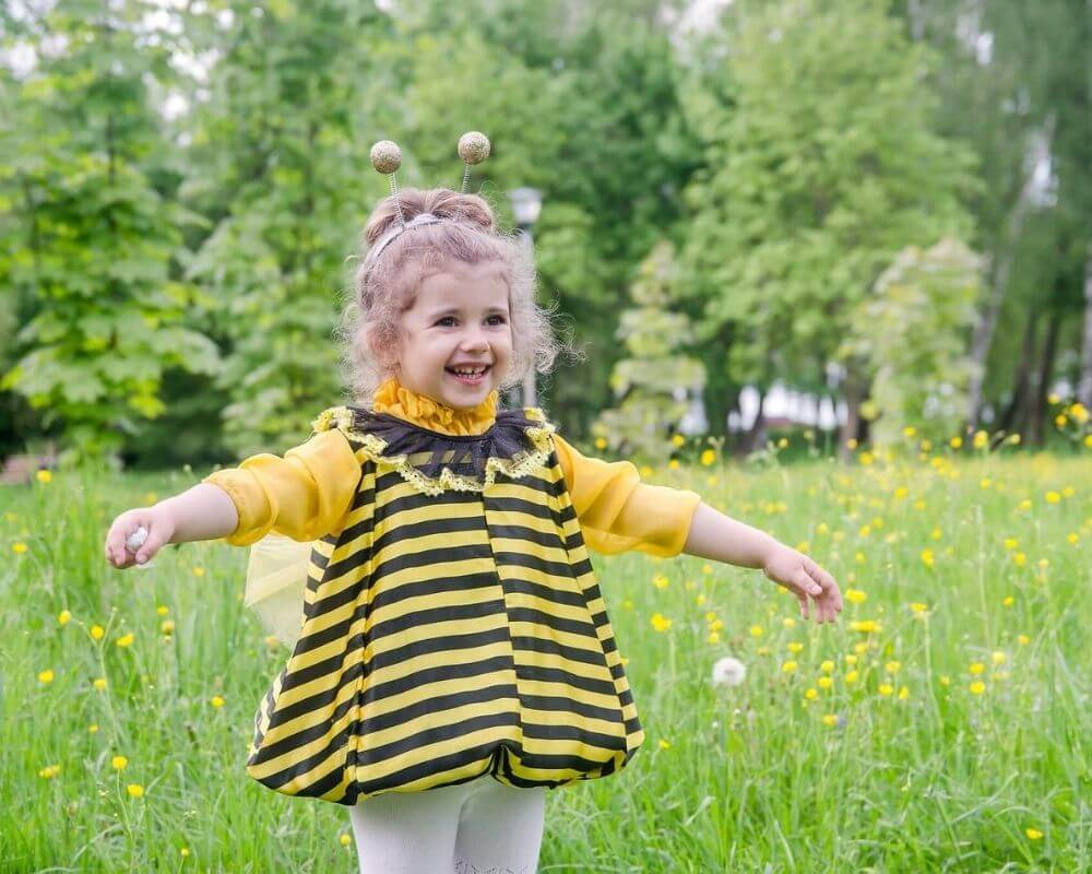 Girl dressed as a bee