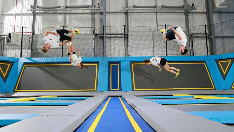 Children do somersaults on the trampolines at Oxygen Freejumping Trampoline Park.