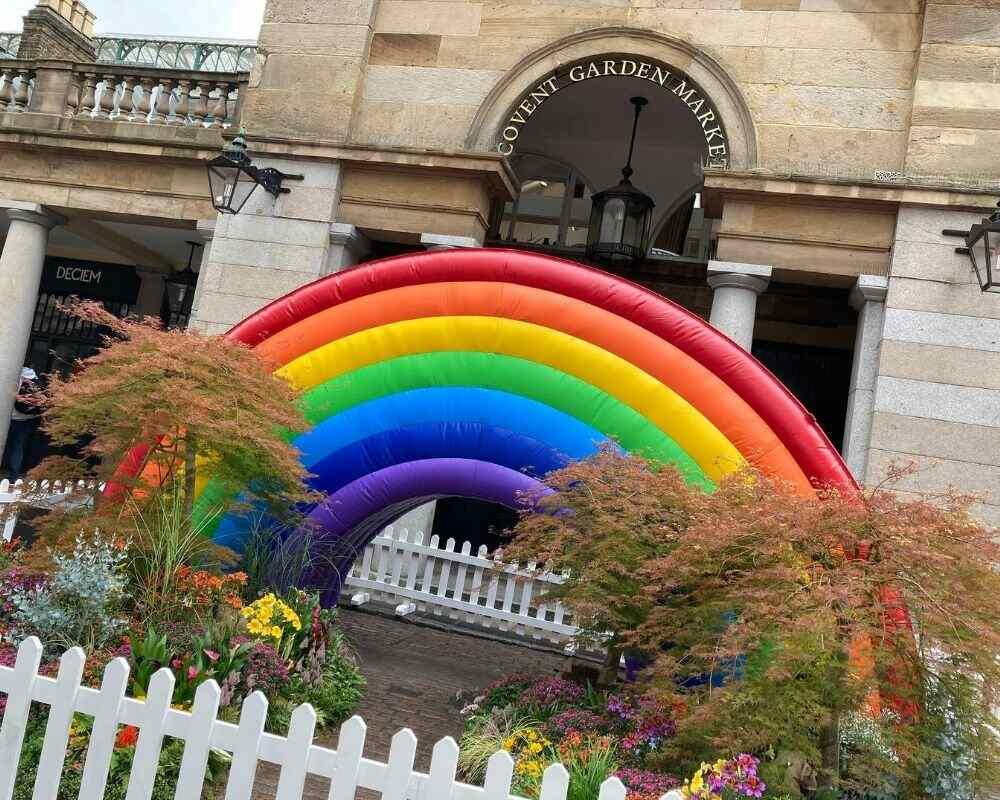 An inflatable rainbow in Covent Garden in London