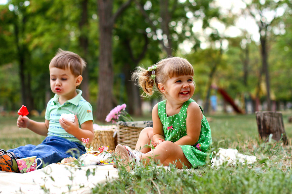 Children enjoying a picnic.