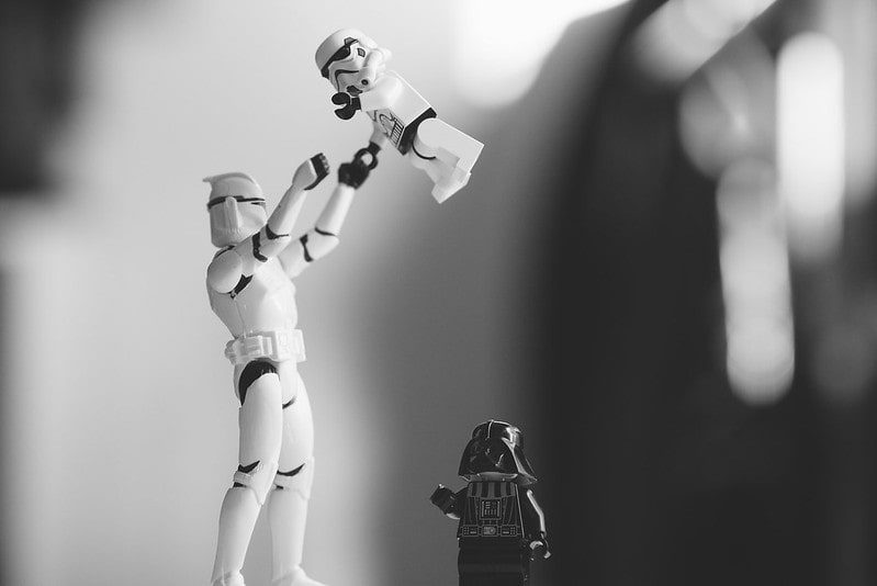 Lego stormtrooper playing with its child.