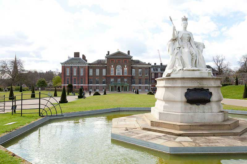 Statue of queen in small pool at Kensington Gardens.