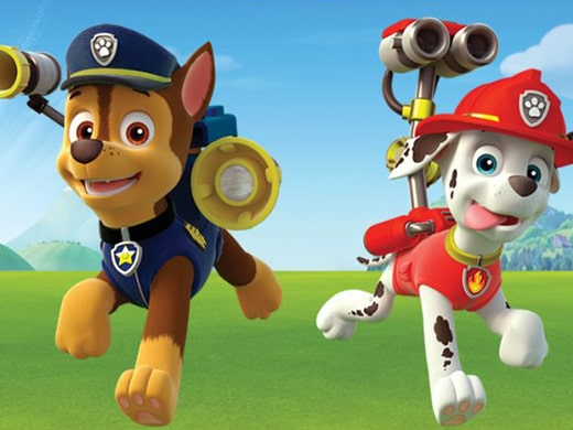 A shot of the dogs in PAW Patrol running across the grass.