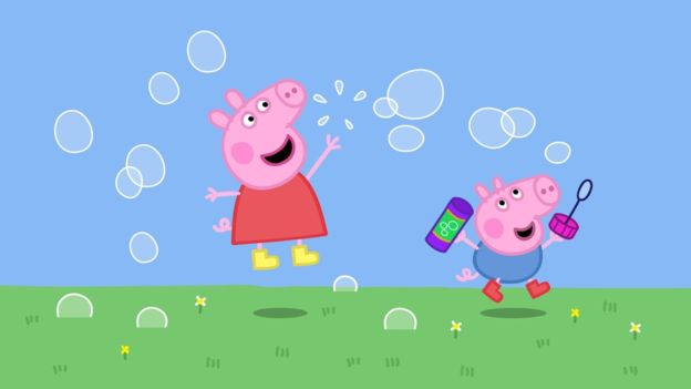 Peppa Pig and George jumping and blowing bubbles outside.