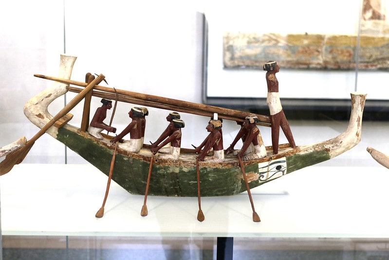 Model of ancient Egyptians on a boat.