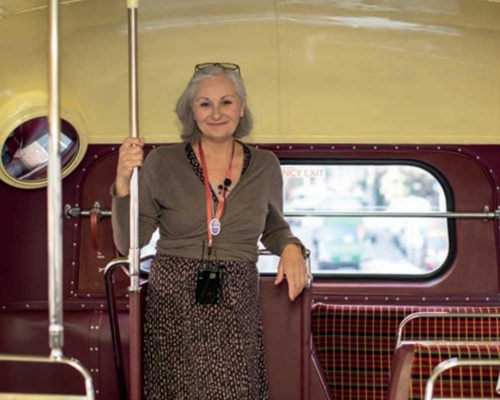 Woman getting onto the Evan Evans coach for one of their tours.