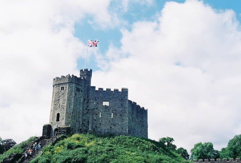 Tudor castle sat atop a hill with the Union Jack flying high.