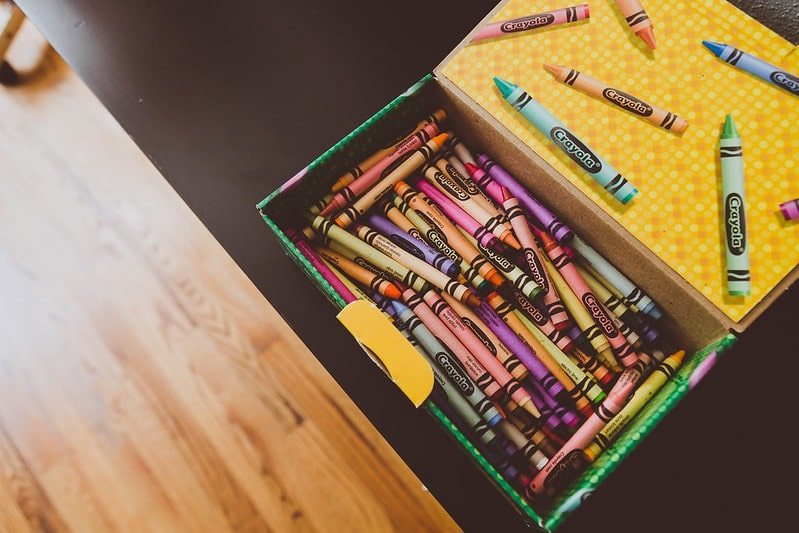 Open box of colouring crayons for fairytale crafts.