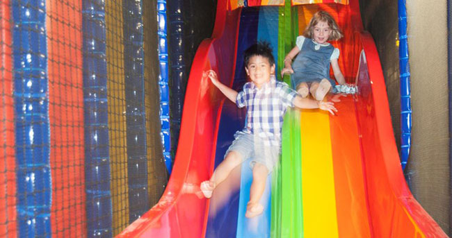Kids on slide at softplay centre