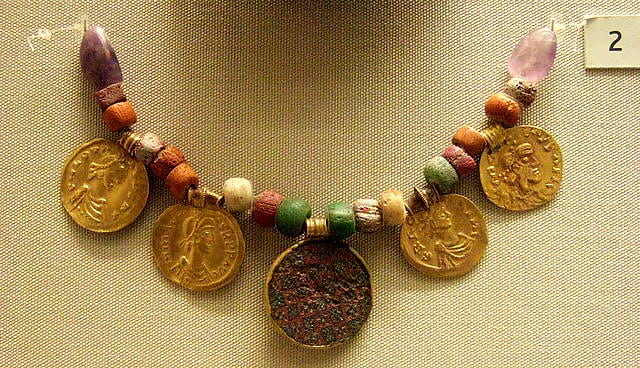 Anglo-Saxon necklace made from beads and large gold coins.