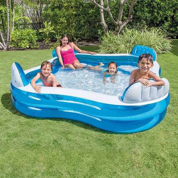 Family lounging in Intex Family Lounge Pool.