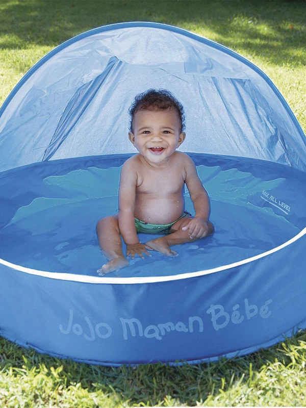 Baby laughing in a Baby Pop Up Pool.