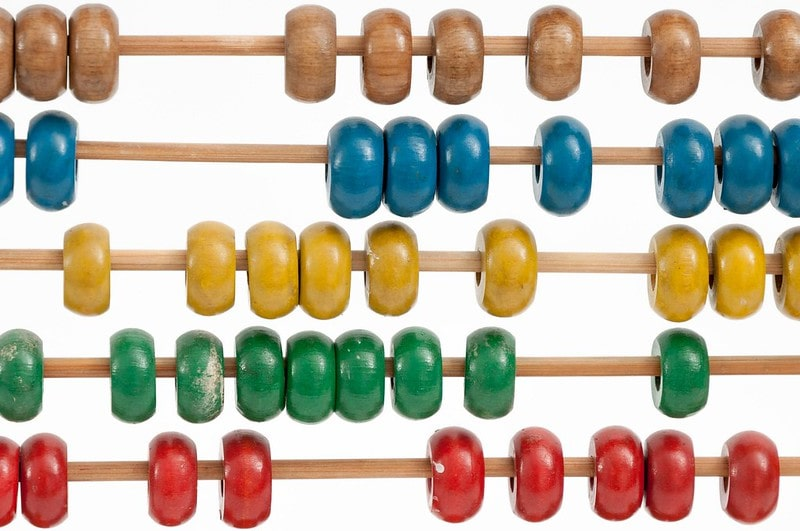 A colourful abacus used as a learning resource for KS2 fractions.