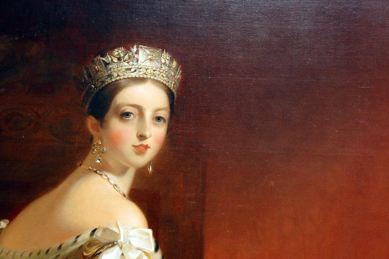 Painting of young Victoria wearing a tiara and lavish jewels.
