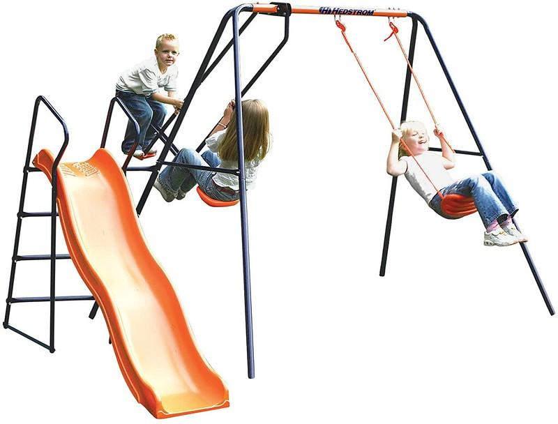 Children playing on the Hedstrom Saturn Garden Slide Set.