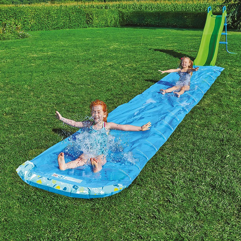 Children sliding down the TP Toys 6m Aqua Slide.