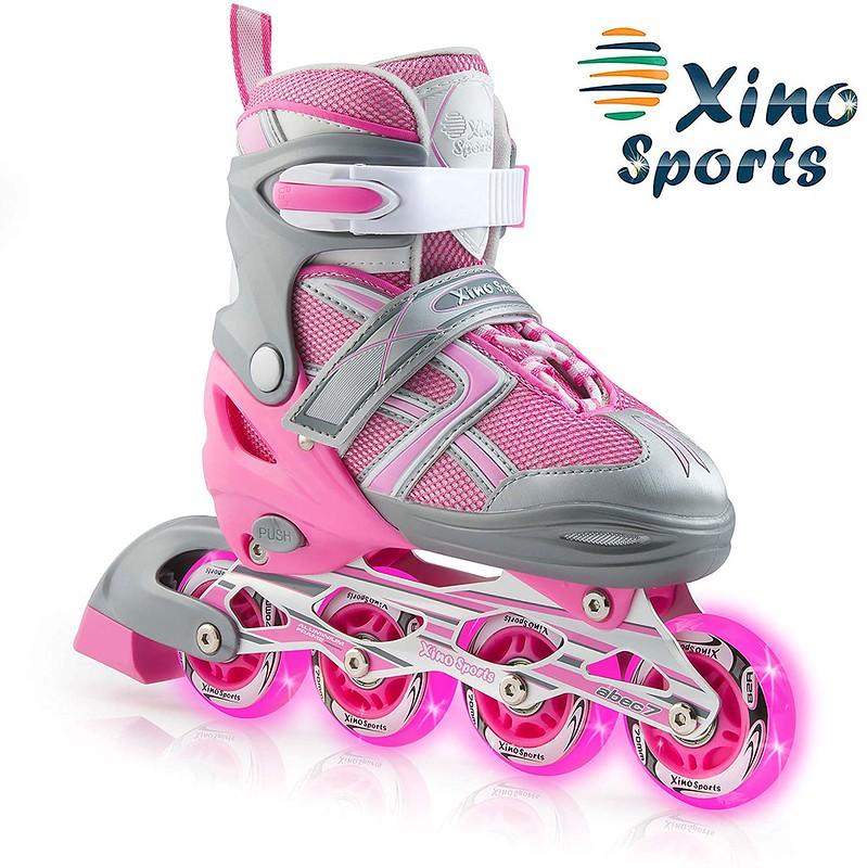 Pink and grey Xinosports roller skates.