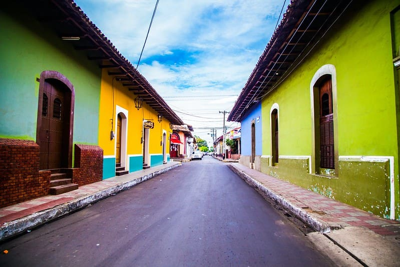 Street lined with colourful houses in Leon, Nicaragua.