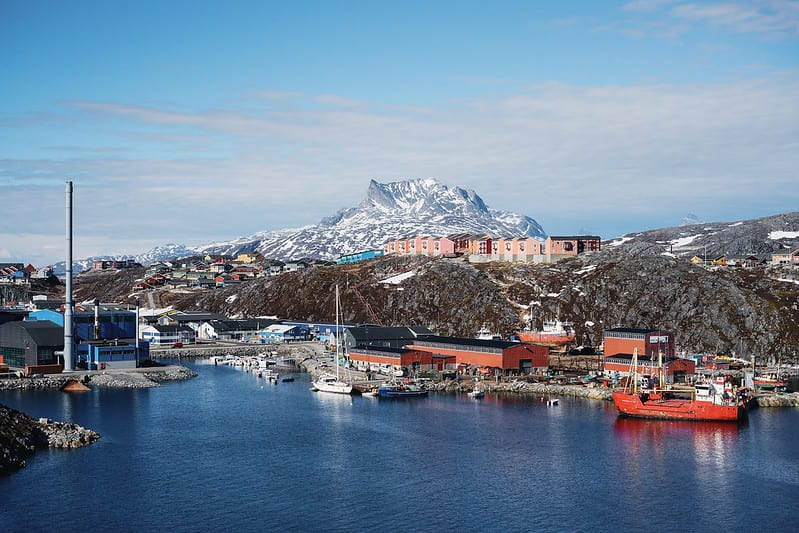 View of the capital city, Nuuk, with a port in front and a mountain behind.