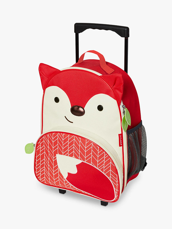 A Skip Hop Zoo wheelie suitcase with the design of a red fox.