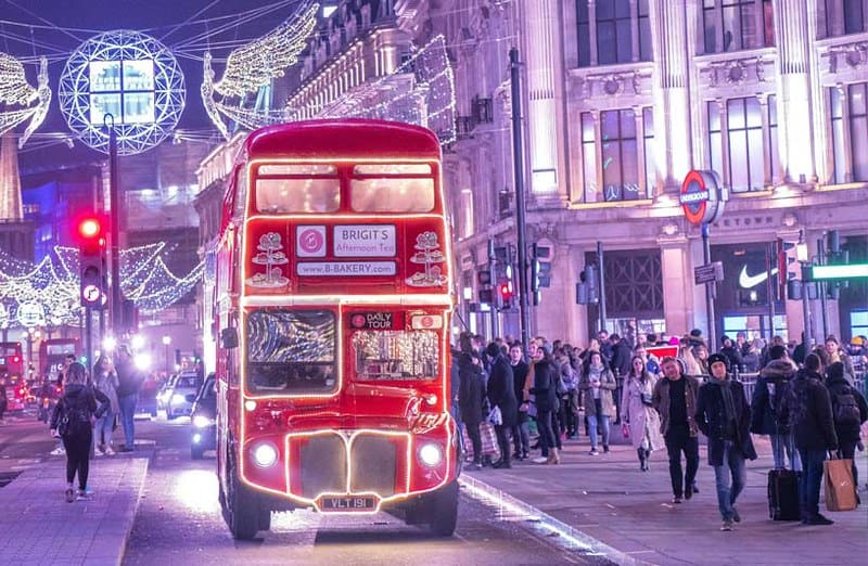 The B Bakery bus driving through London streets and Christmas lights.
