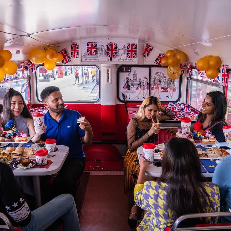 People enjoying B Bakery's afternoon tea bus tour.