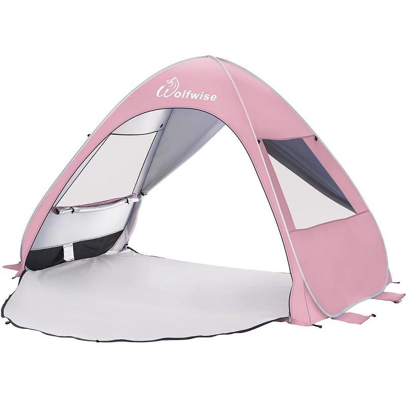 A light pink Wolfwise UPF Beach Pop Up Tent.