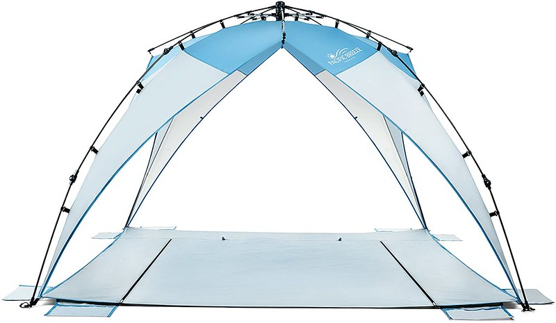 A light blue Pacific Breeze Sand And Surf Beach Tent.