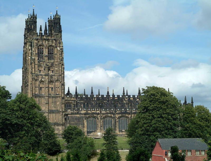 St Giles church in Wrexham, the church tower standing tall compared to the surrounding houses.