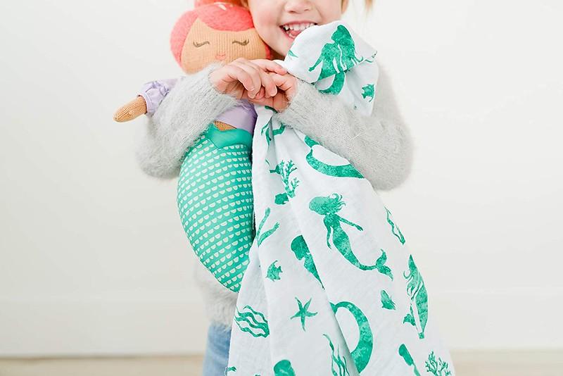 An Addison Belle Mermaid Muslin Swaddle Blanket.