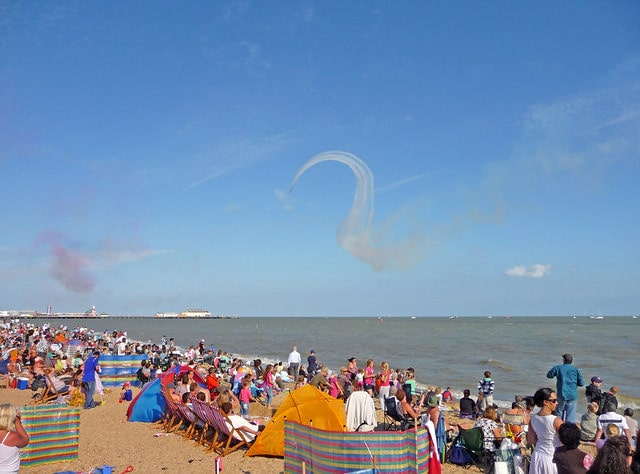 Busy beach at Clacton-on-Sea, everyone enjoying the sunny day.