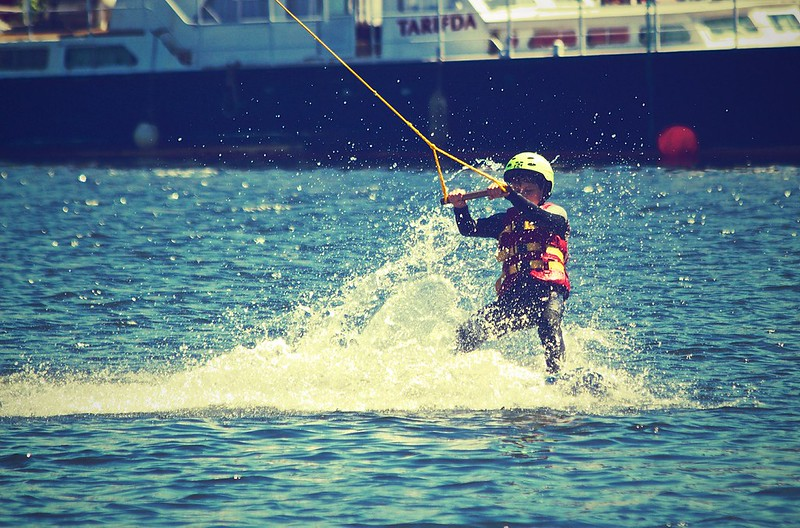 Young boy on waterski with helmet and lifejacket