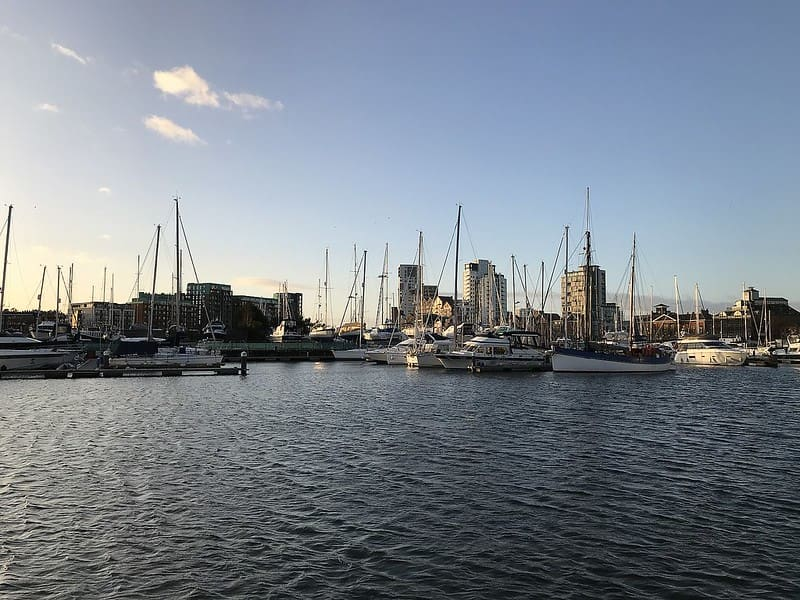 Lots of sailboats docked at Ipswich waterfront in the late afternoon.