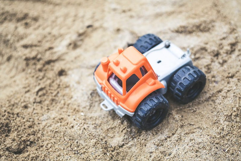 An orange toy digger in the sand in Hull.