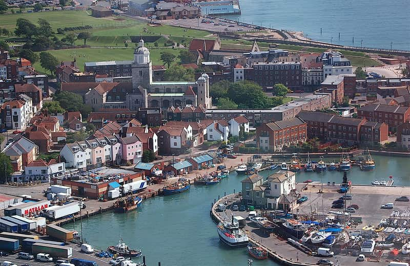View of Old Portsmouth from above, set on the waterfront with colourful houses.