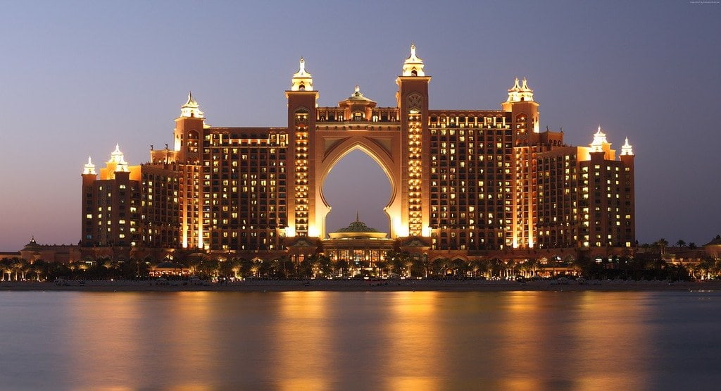 The luxury Atlantis The Palm hotel in Dubai, lit up at night time.