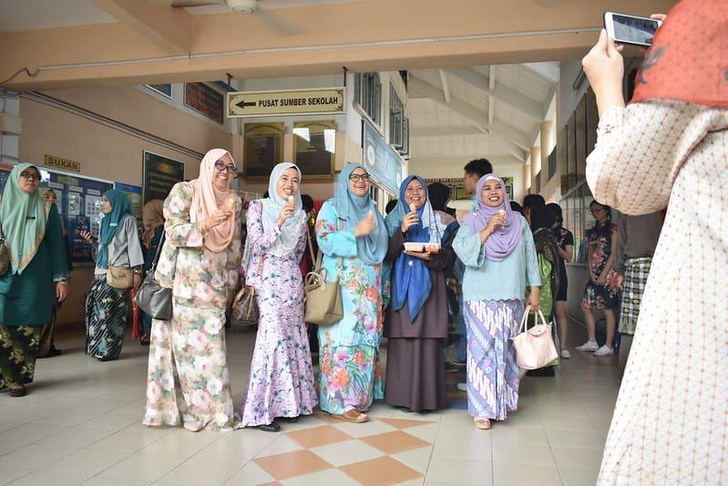 Five women in headscarves in Malaysia, celebrating Eid.