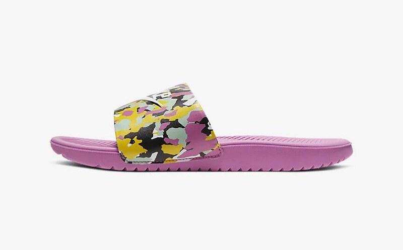 A pair of pink Nike Kawa SE MCs.