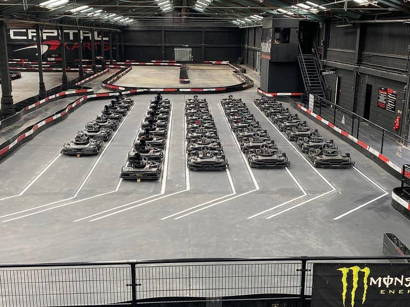 Indoor go-karting course at Capital Karts has go-karts all lined up ready to go.