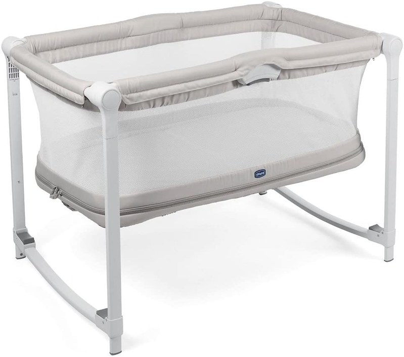 White and beige Chicco Zip And Go Travel Cot.