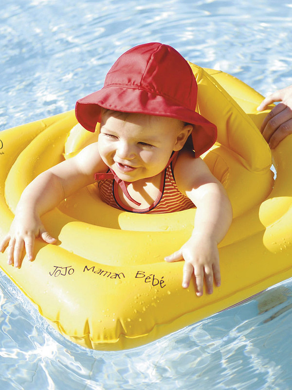 A baby in a Baby Swim Float.
