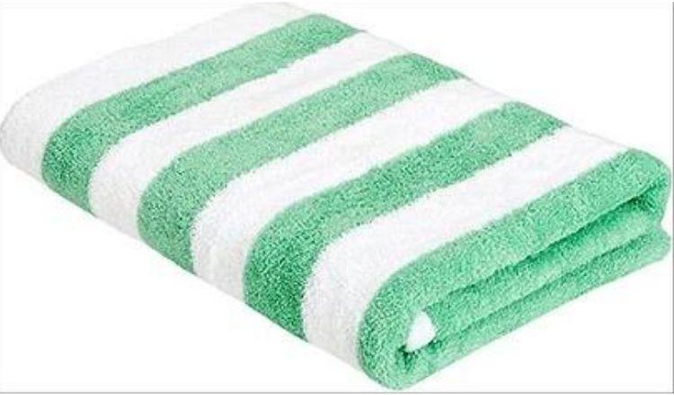 Green and white Amazon Basics Beach Towel by Amazon.