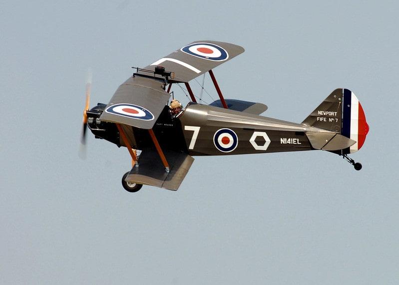 A World War 1 RAF plane flying through the sky.