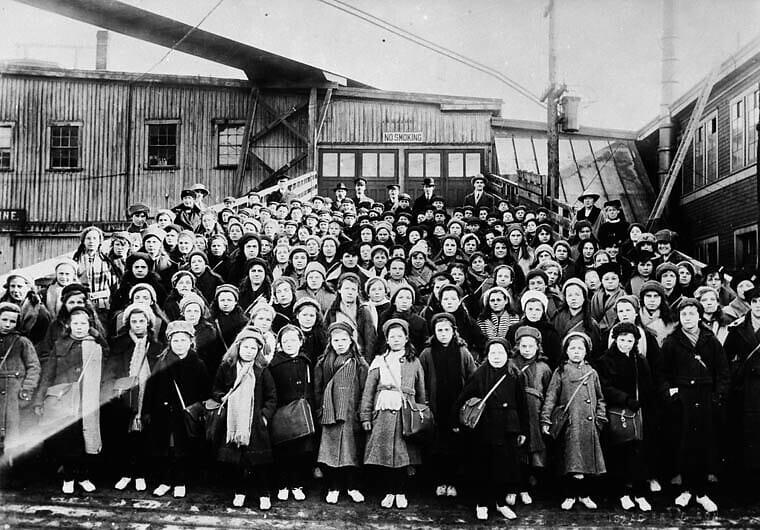 Black and white photo of children standing outside Dr Barnardo's home.