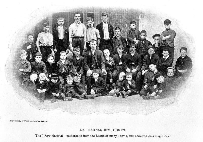 Black and white photograph of young boys outside a boys' Dr Barnardo's home.