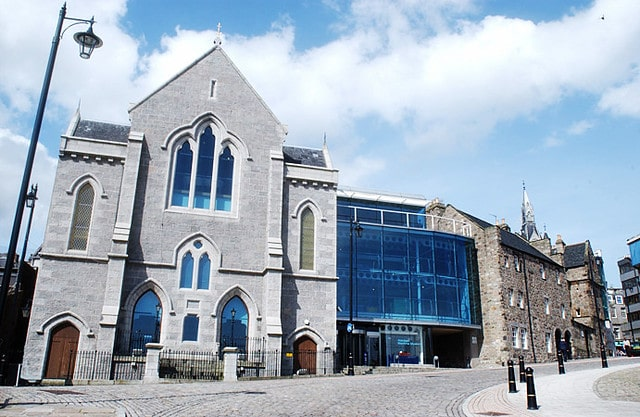 The outside of the Aberdeen Maritime Museum, a grey building with blue glass windows.