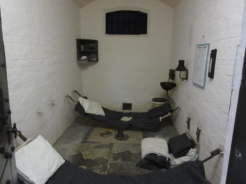 A cell in a Victorian prison with 3 mattresses in a single cell.