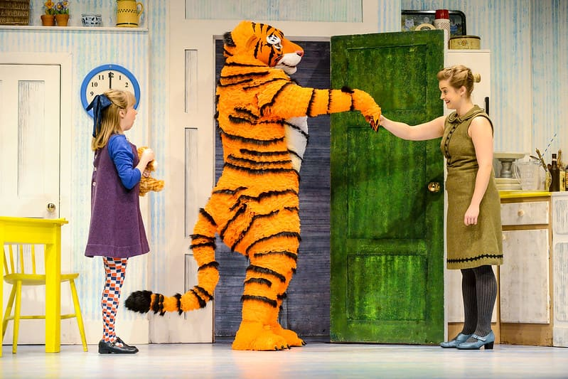 The Tiger Who Came to Tea shaking Sophie's mother's hand.